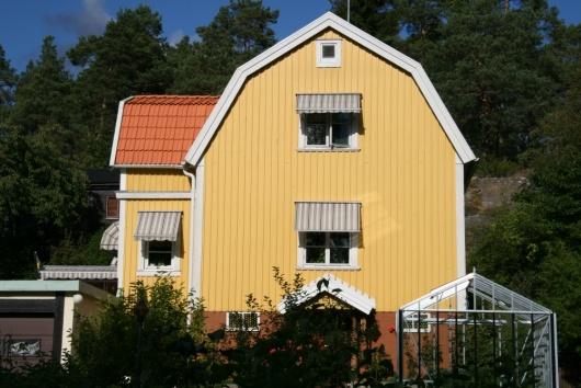 träfasad-fasadrenovering-stockholm